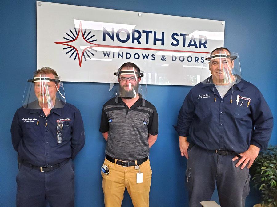 Team members wearing PPE visors